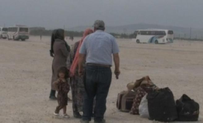 Şam'dan tahliye edilen ilk kafile Halep'e ulaştı