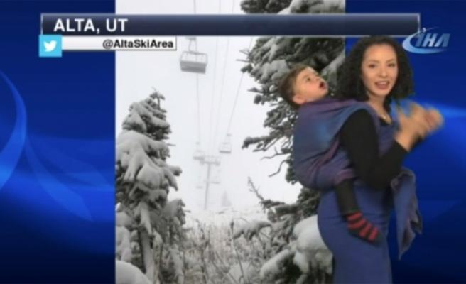 Hava durumunu çocuğuyla birlikte sundu